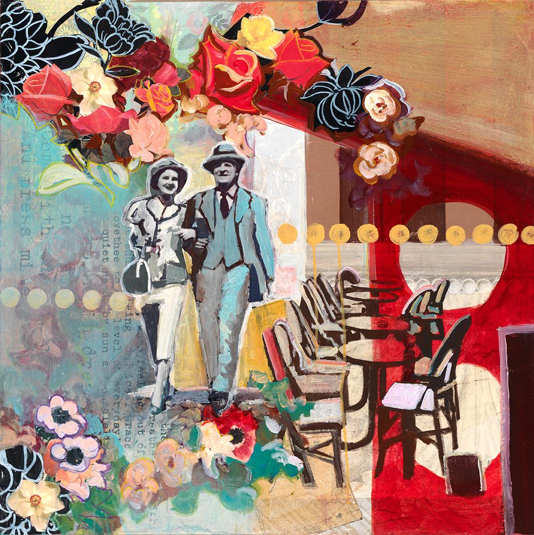 couple walking beside a cafe in paris