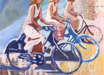 three women on bikes